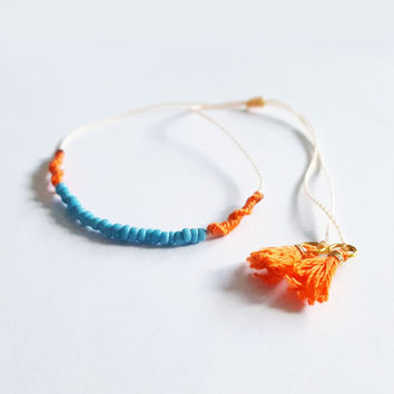 Delicate thin dainty tassel ends woven bracelet orange pink turquoise bar indie hippie hipster anthropologie free people designer inspired