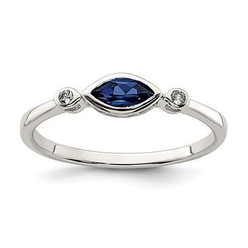 Sterling Silver Bezel Set Marquise Created Blue Sapphire And White Topaz Ring
