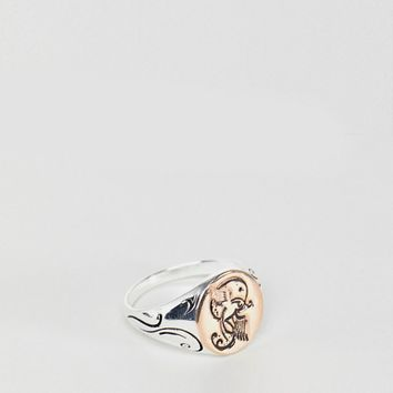 Reclaimed Vintage inspired sterling silver signet ring with embossed bird exclusive at ASOS at asos.com