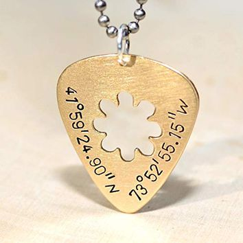 bronze guitar pick necklace with flower cut out and latitude and longitude