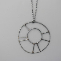 Handmade jewelry. Sterling silver with blackening patination wheel necklace.