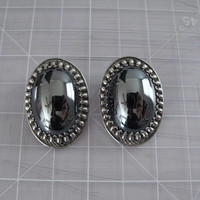 Whiting & Davis earrings - 60s vintage hematite silver black metallic mirror clip-on designer costume jewelry big oversized oval Cabachon
