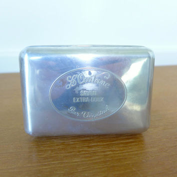 Metal L'Occitane travel soap dish, possibly aluminum