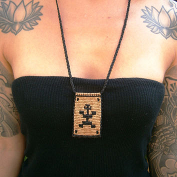 Macramé necklace precolumbian style and native symbol.