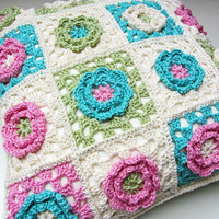 Crochet flower cushion pillow in cream, blue, green and pink