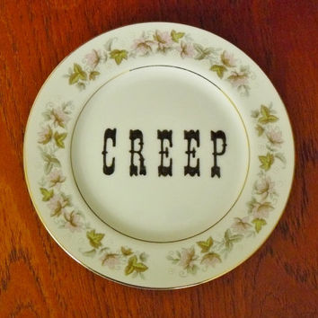 Creep hand painted vintage porcelain bread and butter plate with hanger recycled humor creepy display