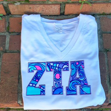 Custom Preppy Appliqued Vneck in Greek Letters with Lily Pulitzer fabric. Sorority