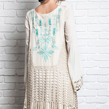 boho style crochet vest featuring open front, sleeveless, crochet knit throughout and contrast with semi-sheer woven fabrication with mint color southwestern pattern embroidery detailing, knit fringe asymmetrical bottom hem.