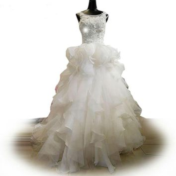 Tiered ruffled wedding gown with hand stitched flowers wedding dress