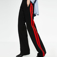 TROUSERS WITH SIDE BANDDETAILS