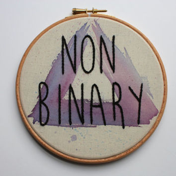 hand embroidered non-binary embroidery hoop art. abstract purple triangle non binary wall art