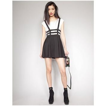 Cage suspenders skirt
