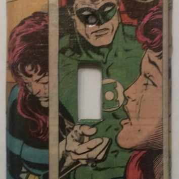 Light switch plate covered in vintage Green Lantern comic sheet