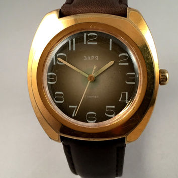 "Chunky Vintage Mens Soviet watch ""ZARIA""/ ZARJA .This is mechanical watch, with a lovely dial finish.Comes with new leather strap."