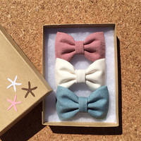 Textured mauve, textured teal, and winter white hair bows from seaside sparrow. Beautiful birthday gift for her.