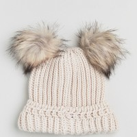 River Island Double Faux Fur Pom Pom Beanie Hat at asos.com
