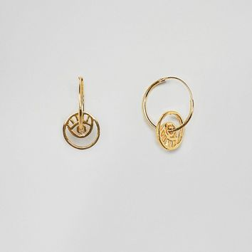 ASOS DESIGN gold plated sterling silver hoop earrings with cut out eye detail at asos.com