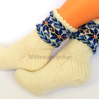 Hand knitted wool socks Warm socks Winter socks Patterned socks with blue colored latvian star ornament on a white background Knitted socks