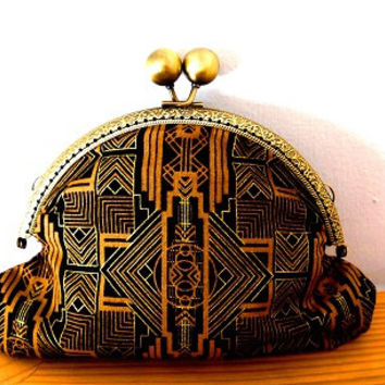 Art deco/1920s/black/gold/geometric print/small clasp/clutch bag