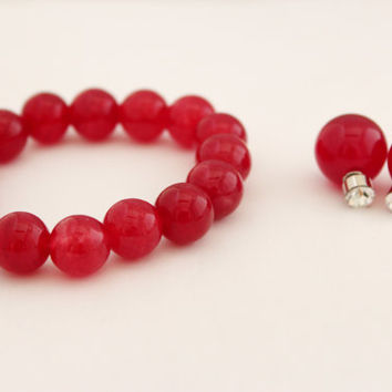 A set of masala red stone beaded bracelet with spotlight red double sided earrings