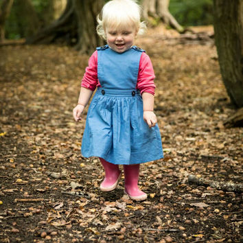 Girls pinafore. Dusty blue toddler dress. Fully lined button fastening with pockets.