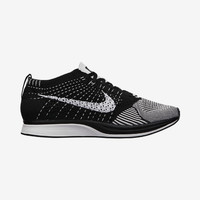 The Nike Flyknit Racer Unisex Running Shoe (Men's Sizing).