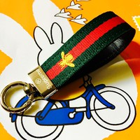 Car keys, leather remote-control waist accessories, men's high-end chains, red and green belt decoration
