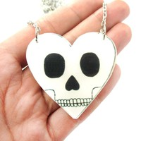 Love You To Death: Heart Shaped Skull Pendant Necklace in Acrylic | DOTOLY