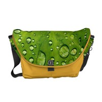 Raindrops on taro leaf courier bag