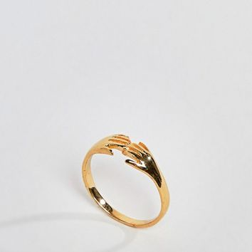 ASOS DESIGN Curve ring in gold plated sterling silver in vintage style hand design at asos.com
