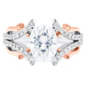 9 x 7mm Oval Moissanite 14K Two-Tone White and Rose Gold 4 Prong Diamond Accent Ring