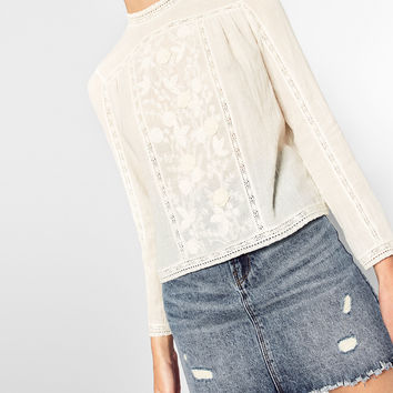 EMBROIDERED TOP WITH HIGH NECK DETAILS