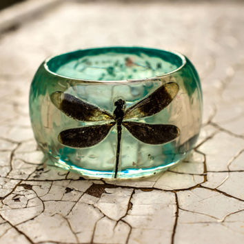 Dragonfly Real taxidermy isnect inside of the Resin Bangle Bracelet. Blue Colored Resin with White Flowers Baby Breath. Something Special