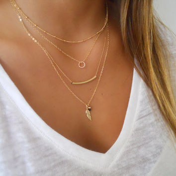 Delicate set of 4 Gold Necklaces;  Layered Gold Filled Necklace Set; Satellit, Tiny Ring, Tube and Feather Necklaces; 4 Necklace Set