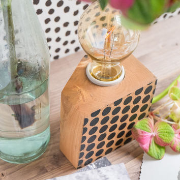 Small wood lamp with black polka dot decor on one side