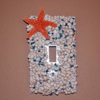 Ocean Themed Light Switch Cover With Medium size Starfish Blue Cone Shells and White Litonia Shells