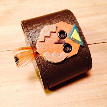 leather bracelet cuff with tiny leather owl with feather adornment with snap closure in browns and rust