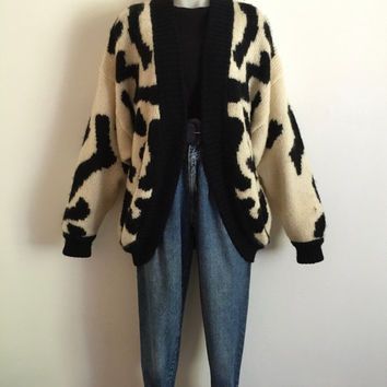 Vintage 1980s oversized cream and black hand knit wool cardigan with leopard markings and large centre back cat face