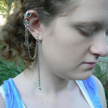 fairy  on moon ear cuff with chains in fantasy boho gypsy hipster and hippie style