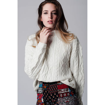Cream cable knit sweater with ribbed collar