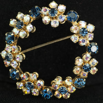 Weiss Circle Brooch Blue Clear Rhinestone Floral Motif Designer Signed Gold Tone Vintage - Weiss Rhinestone Wreath Signed
