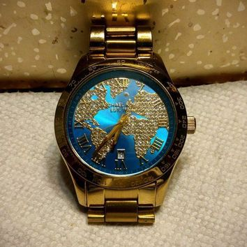 DCCKLO8 Michael Kors Layton Gold Tone Watch MK6375