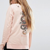 Criminal Damage Oversized Long Sleeve Sweat T-Shirt With Dragon Back Print at asos.com