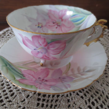 Pink Handpainted Footed Floral Teacup and  Saucer Set.