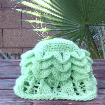 Baby sunbonnet with knit scalloped lace trim and crochet broomstick lace and crocodile stitch in acrylic yarn