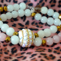 Pink and White Gemstone Bracelet Paired With a White and Gold Disco Bead