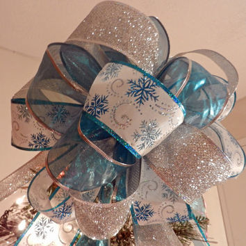 Lg. Xmas tree topper Sheer Teal Ribbon, Wht ribbon w/ teal and silver snowflakes, silver glitter ribbon 8 ft. tails and 6 bow ornaments