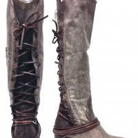 This a striking hand-distressed knee high boots features a vintage inspired washed leather throughout, a round toe, contrast with tonal suede backs & leather lacing that wraps multiple times around the ankle and laces up to topline, partially side zip clos