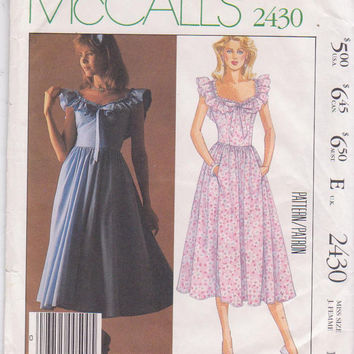 Vintage 1980s Laura Ashley pattern for ruffled bodice sleeveless sun dress with scoop neckline misses size 12 McCalls 2430 UNCUT