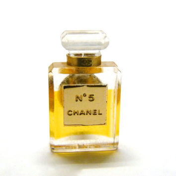 Authentic vintage CHANEL No 5 pin brooch.